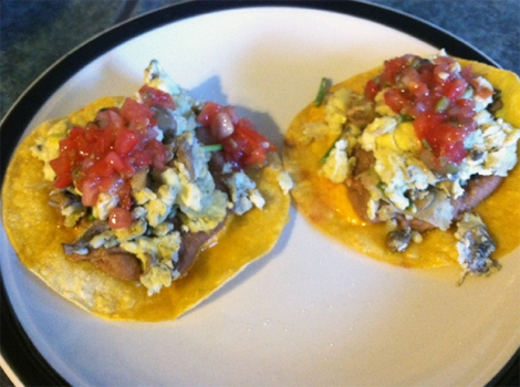 Breakfast tacos with refried beans, scrambled eggs and mushrooms